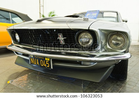 BANGKOK - JUNE 24 : Ford Mustang (1969) on display at The 36th Bangkok Vintage Car Concours on June 24, 2012 in Bangkok, Thailand. - stock photo