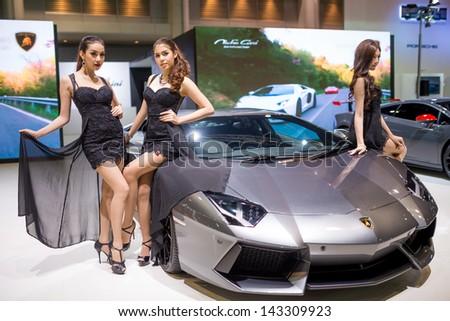 Bangkok - June 20 : Lamborghini Aventador with pretty girls on display at The 2nd Bangkok International Auto Salon 2013 in June 20, 2013 in Bangkok - stock photo
