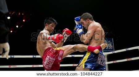 "BANGKOK - JUNE 9: Muay Thai Welterweight World Championship fight - Big Ben Ch. Praram 6 (Thailand) kicking Fabio Pinca (France) at ""BATTLE FOR THE BELTS"" event on June 9, 2012 in Bangkok, Thailand - stock photo"