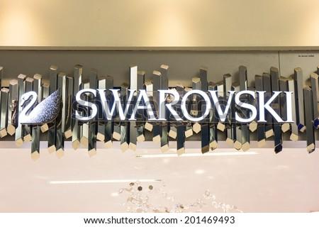 BANGKOK - JUNE 17: The sign of Swarovski at Swarovski store in Suvarnabhumi International Airport, Bangkok on Jun 17, 2014. Swarovski is an Austrian producer of luxury cut lead glass (crystal). - stock photo