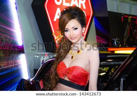 BANGKOK - JUNE 20 : Unidentified model on display at Bangkok International Auto Salon 2013 Exciting Modified Car Show on June 20, 2013 in Bangkok, Thailand. - stock photo