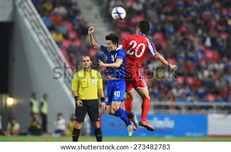 BANGKOK, MAR31:Chaowat.V(B) of Thailand in action during AFC U-23 Championship 2016(Qualifiers) between Thailand and DPR Korea at Rajamangala stadium on March 31, 2015 in Bangkok, Thailand.  - stock photo