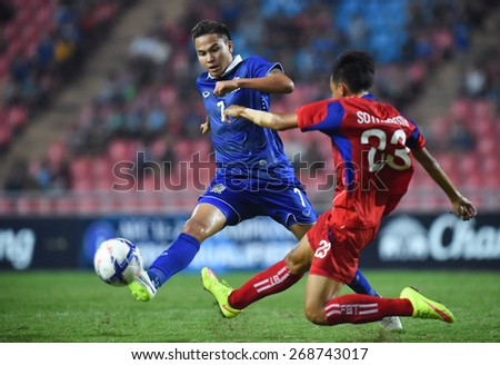 BANGKOK, MAR 27: P.THITIPHAN(B) of Thailand in action during AFC U-23 Championship 2016 (Qualifiers) between Thailand and Cambodia at Rajamangala stadium on March 27, 2015 in Bangkok, Thailand.  - stock photo