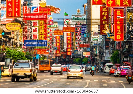 BANGKOK - MARCH 03: Busy Yaowarat Road in the evening on March 03, 2013 in Bangkok. Yaowarat Road is a main street in Bangkok's Chinatown, it was opened in 1891 in the reign of King Rama V. - stock photo