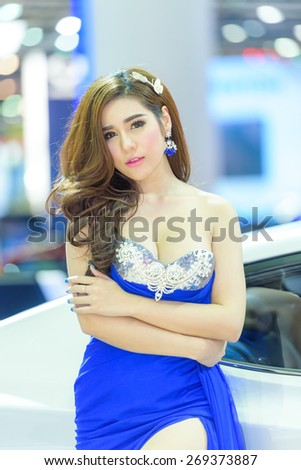 "BANGKOK - MARCH 24 : Female presenters model with Hyundai car on display at The 36th Bangkok International Motor Show ""Art of Auto"" on March 24, 2015 in Bangkok, Thailand. - stock photo"
