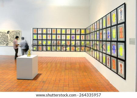 BANGKOK - MARCH 7: People look at painting and sculpture during Thai Contemporary Art Exhibition on March 7, 2015 at The National Gallery in Bangkok, Thailand. - stock photo
