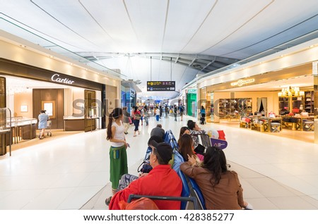 BANGKOK - MARCH 18, 2016: Unidentified air passengers walk and shop at the duty free area of the International Airport Suvarnabhumi which is the sixth busiest airport in Asia. - stock photo