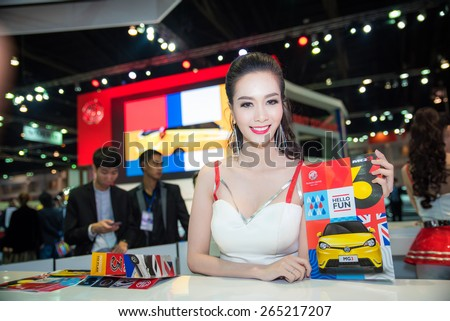 BANGKOK - March 24, 2015 : Unidentified model with MG car on display at The 36th Bangkok International Motor show on March 24, 2015 in Bangkok, Thailand.   - stock photo