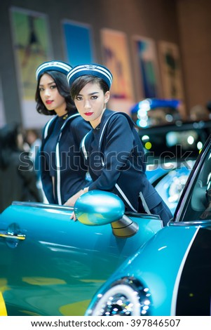 BANGKOK - March 26, 2016 : Unidentified model with Mini car on display at the 37th BANGKOK INTERNATIONAL MOTOR SHOW 2016 on March 26, 2016 in Bangkok, Thailand. - stock photo