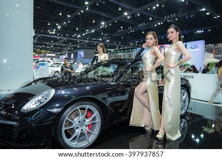 BANGKOK - March 27, 2016 : Unidentified model with Porsche car on display at the 37th BANGKOK INTERNATIONAL MOTOR SHOW 2016 on March 27, 2016 in Bangkok, Thailand. - stock photo