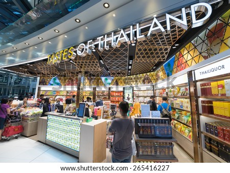 BANGKOK - MARCH 18; 2015: Unidentified people shop food at a duty free shop at the International Airport Suvarnabhumi which is the sixth busiest airport in Asia. - stock photo