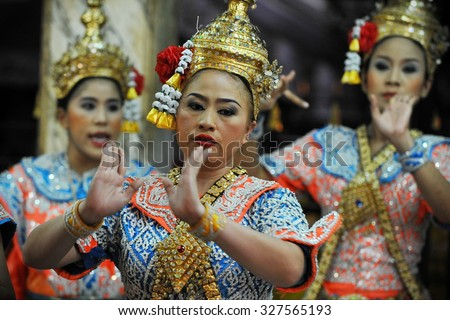 BANGKOK - MAY 24: A troupe perform classical Thai dance or Lakhon Nai at the Erawan Shrine on May 24, 2013 in Bangkok, Thailand. Lakhon Nai originated in the royal court of Thailand. - stock photo