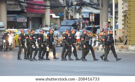 BANGKOK - MAY 30: Military police deploy on a city centre street following a military coup on May 30, in Bangkok, Thailand. The Thai capital is under martial law after Thailand's 19th coup d'etat. - stock photo