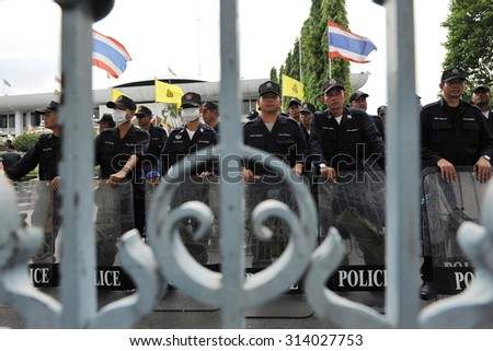 BANGKOK - MAY 31: Police officers stand guard outside the Thai Parliament as anti government protesters hold a rally in the vicinity on May 31, 2013 in Bangkok, Thailand. - stock photo