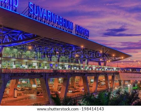 BANGKOK- MAY 17.  Suvanaphumi Airport at twilight on May 17, 2014 in Bangkok. Suvarnabhumi airport is world's 4th largest single-building airport terminal. - stock photo
