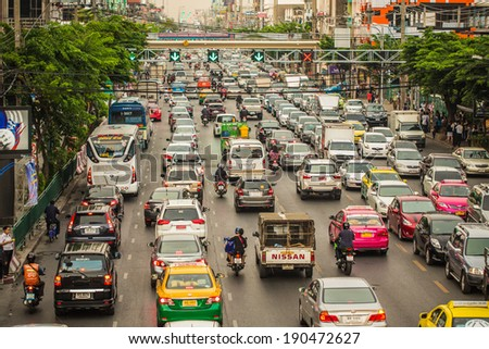 BANGKOK - MAY 2: Traffic moves slowly along a busy road on May 2, 2014 in Bangkok, Thailand. Annually an estimated 150,000 new cars join the already heavily congested streets of Bangkok. - stock photo