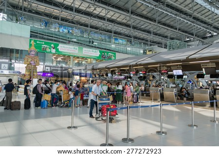BANGKOK - MAY 12: Unidentified passengers arrive at the check-in counters at the new Suvarnabhumi Airport, May 12, 2015 in Bangkok, Thailand. The airport is one of the busiest in Asia. - stock photo