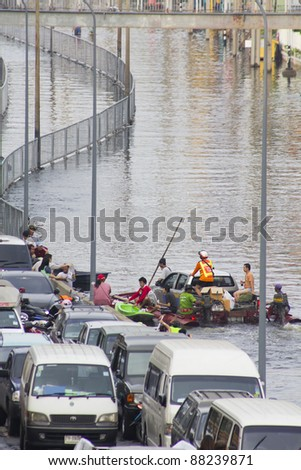 BANGKOK-NOV 5:Flood hits Bangkok areas around Tollway, higher water levels than expected,transportation affected by flood on November 5, 2011 on vibhavadee Rd,Thailand (Jatujak Area) - stock photo