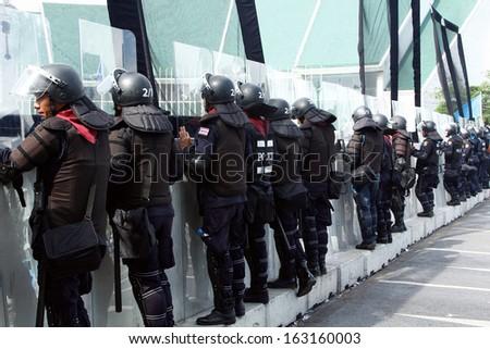 BANGKOK - NOV 10: Riot police stand guard near parliament during  anti-government rally on Nov 10, 2013 in Bangkok, Thailand. Protests surrounding an amnesty bill - stock photo