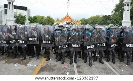 BANGKOK - NOV 24: Riot police stand guard on Makhawan Bridge during a violent anti-government rally on Nov 24, 2012 in Bangkok, Thailand. Protesters and police clashed repeatedly with dozens injured. - stock photo