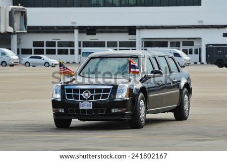 BANGKOK - NOV 18: The Presidential State Car motorcade drives on Don Muang International Airport taxiway as US President Barack Obama begins his SE Asia tour on Nov 18, 2012 in Bangkok, Thailand. - stock photo
