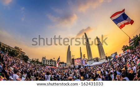 BANGKOK - NOVEMBER 11: 210,000 of Thailand's  protest at Democracy Monument against the government at Ratchadamnoen road on November 11, 2013 in Bangkok, Thailand. - stock photo