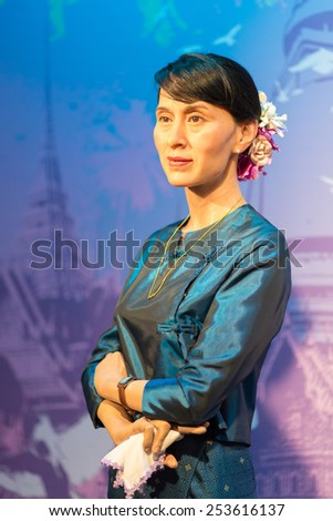 BANGKOK - OCT 21: A waxwork of Aung San Suu Kyi on display at Madame Tussauds on Oct 21, 2012 in Bangkok, Thailand. Madame Tussauds' newest branch hosts waxworks of numerous stars and celebrities. - stock photo