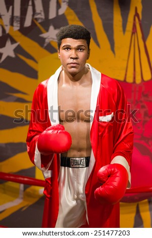 BANGKOK - OCT 21: A waxwork of Muhammad Ali on display at Madame Tussauds on Oct 21, 2012 in Bangkok, Thailand. Madame Tussauds' newest branch hosts waxworks of numerous stars and celebrities. - stock photo