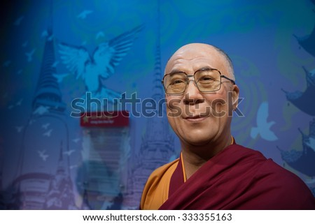 BANGKOK - OCT 28: A waxwork of The Dalai Lama on display at Madame Tussauds on October 28, 2015 in Bangkok, Thailand. Madame Tussauds' newest branch hosts waxworks of numerous stars and celebrities. - stock photo
