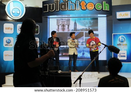 BANGKOK - OCT 10: Unidentified presenters broadcast from Digital Gateway electronics mall on Oct 10, 2012 in Bangkok, Thailand. Digital Gateway houses over 100 retail outlets, stores and restaurants. - stock photo