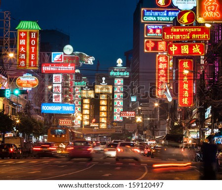 BANGKOK - OCTOBER 20: Busy Yaowarat Road in the evening on OCT 20, 2013 in Bangkok. Yaowarat Road is a main street in Bangkok's Chinatown, it was opened in 1891 in the reign of King Rama V. - stock photo