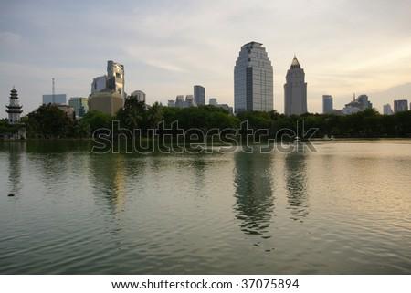Bangkok park at dusk - stock photo