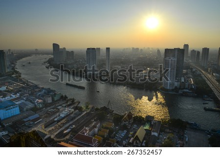 Bangkok sky line with huge park before sunset - stock photo