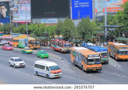 BANGKOK THAILAND - APRIL 19, 2015: Buses at Victory monument bus stop. Bangkok is famous for its heavy traffic congestion.  - stock photo