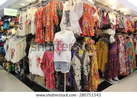 Bangkok, Thailand - April 16, 2015: Many clothes are displayed for customers to chose at Platinum Fashion Mall, a shopping mall specializing in fashion clothes and accessories in Bangkok, Thailand. - stock photo