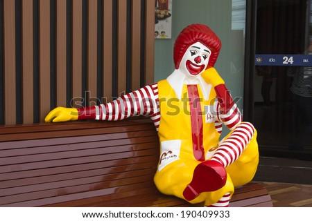 BANGKOK, THAILAND - APRIL 10 : Ronald McDonald character sitting on bench at McDonald Restaurant on April 10, 2014, Thailand. McDonald's Corporation is the world's largest burger fastfood restaurants. - stock photo