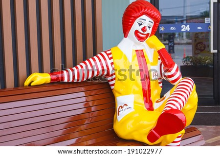 BANGKOK, THAILAND - APRIL 10 : Ronald McDonald character sitting on bench at McDonald Restaurant on April 10, 2014, Thailand. McDonald's Corporation is the world's largest burger fastfood restaurants. - stock photo