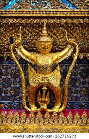 Bangkok, Thailand - April 11, 2011: sculptures of Garuda and Naga in the Wat Phra Kaew temple, Bangkok, Thailand. Garuda is a birdlike mythological beast of the Hindu and Buddhist tradition.  - stock photo