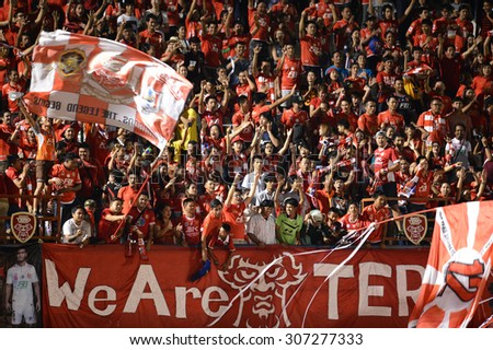BANGKOK THAILAND- AUG 16: BEC Tero Sasana fans cheering during the competition Thai Premier League 2015 between BEC and Chonburi FC at Minburi Stadium on August 16, 2015 in Bangkok, Thailand. - stock photo