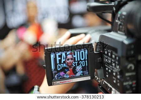 BANGKOK, THAILAND - AUG 7, 2012: View of a camera electronic viewfinder as a presenter gives an interview of a street fashion TV show. - stock photo