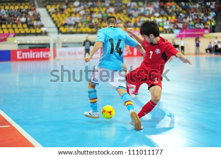 BANGKOK THAILAND - AUGUST 24 : Alex Yepes (B) in action during Friendly futsal match Between Thailand VS Spain at Nimibutr Stadium on August 24,2012 in Bangkok,Thailand. - stock photo