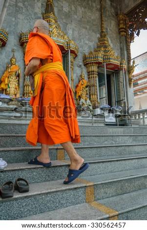 Bangkok, Thailand - August 29, 2015 : Thai monk walking in temple to worship in Wat Hua Lamphong. Wat Hua Lamphong is a Royal Buddhist temple, third class, in the Bang Rak District of Bangkok. - stock photo