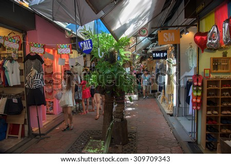 BANGKOK, THAILAND - AUGUST 22, 2015: Unidentified people shopping at Jatujak or Chatuchak Market. Here is the largest weekend market open from 8am to 6pm in Bangkok. - stock photo