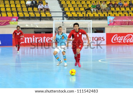 BANGKOK THAILAND - AUGUST 24 : Unidentified player in Friendly futsal match Between Thailand VS Spain at Nimibutr Stadium on August 24,2012 in Bangkok,Thailand. y - stock photo