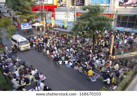 BANGKOK, THAILAND - DEC 22, 2013: Anti-government protesters in Bangkok, Thailand. The protest Against The government in Bangkok, capital of Thailand - stock photo
