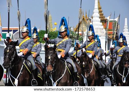 BANGKOK THAILAND- DEC 5: Unidentified Rayal Guard on horse parade in the King of Thailand 's birthday on December 5, 2011 , Bangkok, Thailand. - stock photo