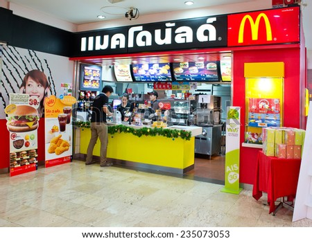 BANGKOK, THAILAND - DECEMBER 1: Exterior view of a McDonald's Restaurant on DECEMBER 1, 2014 in Bangkok, Thailand. It is the world's largest chain of hamburger fast food restaurants. - stock photo