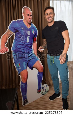 BANGKOK, THAILAND DECEMBER 03: Fabio Cannavaro shot photo with stand display  after he arrives in the lead up to the the Global Legends Series, at the Swisshotel,on Dec 3, 2014 in Bangkok,Thailand. - stock photo