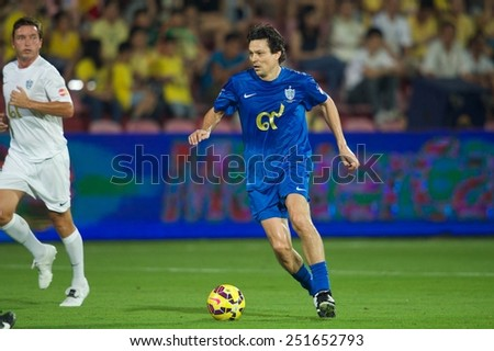 BANGKOK, THAILAND - DECEMBER 05: Jari Litmanen of Team Cannavaro runs with the ball during the Global Legends Series match, at the SCG Stadium on December 5, 2014 in Bangkok, Thailand.  - stock photo