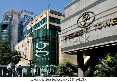 Bangkok, Thailand - December 31, 2010: Left to right - Zen Department Store,  Gaysorn Shopping Center and President Towers Hotel entrance on Sukhamvit Road - stock photo